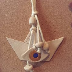 Boat lucky charm with evil eye made of polymer clay. www.polychromo.etsy.com