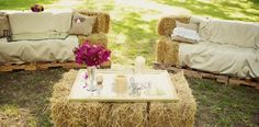 Creative use of hay stacks.  Great for outdoor country style weddings.  Seating, barn chairs, hay sofa, outdoor photo station or simple extra reception seating