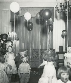 Birthday Party - Bill Brandt- Could photograph my sister with a balloon along sea side or with more relevance to the coast a kite although some people do release balloons at coast to remember loved ones.