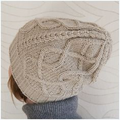 Dwarf's Wife is a slouchy, oversized hat with stylish cable look, which gives you not only the warmth but also versatile ways to wear it.