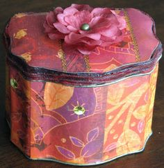 Altered tea tin with BoBunny papers