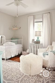 Grey and white neutral nursery. A hint of a pastel shade would make it even more beautiful.