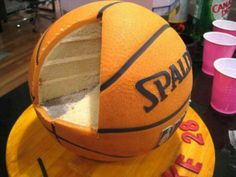 """Basketball cake. We can help achieve this look by checking out our website for cake dummies, cake boards and cupcake stands! 10% off with """"pinterest2013"""" at www.dallas-foam.com"""