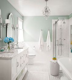 Try a light green color in a white bathroom for a fresh, clean feel.