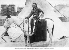 Native American man on horse back holding a single action revolver, Washington State, ca. 1913