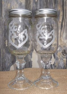 Each Wine Glass is engraved with the Browning buck & doe shaped into the shape of a heart. Perfect for a Country wedding decor.  http://www.facebook.com/cuttingedgecreations