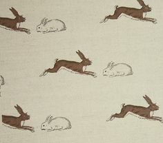 Rabbits & Hares Fabric A playful fabric with rabbits and hares printed in natural earthy brown. The design has great movement and is wonderfully evocative of the British countryside.
