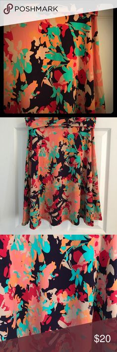 NWOT Lularoe size M silky printed Azure An oh-so pretty NWOT size M Lularoe Azure! Perfect for summer, this light and silky skirt matches so much - a dark navy with te, red, coral, orange and light tan accents. Only tried on, never worn. LuLaRoe Skirts A-Line or Full