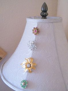 spruce up a plane lampshade and make a unique statement piece just by pinning on a few old pieces of jewelry