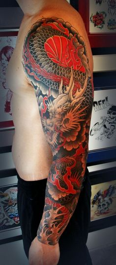 Things you must know about Japanese tattoo art, the history and meaning. Japanese dragon, sleeve, tiger, flower and japanese mask tattoo designs. Red Dragon Tattoo, Dragon Tattoos For Men, Dragon Sleeve Tattoos, Dragon Tattoo Designs, Full Sleeve Tattoos, Tattoos For Guys, Dragon Tattoo Oriental, Men Tattoos, Japanese Tattoos For Men