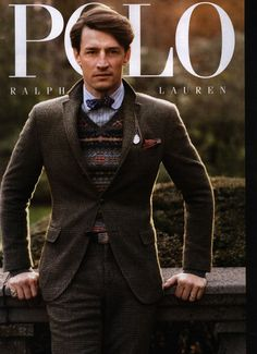 Lets break it down. Notice the use of color. Darker gray tweed suit with no bright colors; exceptional, like the use of the fair isle sweater, and engine turn buckle belt. The chain and fob, with signet ring added a nice touch.