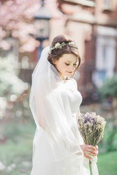 David's Bridal bride Holly in a strapless gown and tulle veil tppped with a flower crown at her London wedding #DavidsBridalUK