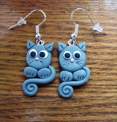 Account suspended Gray cats Also available in black. Polymer Clay Cat, Polymer Clay Ornaments, Polymer Clay Christmas, Polymer Clay Animals, Polymer Clay Projects, Polymer Clay Charms, Polymer Clay Creations, Polymer Clay Earrings, Clay Cats