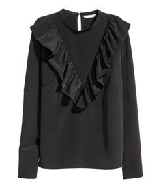 Black. Straight-cut, long-sleeved blouse in woven fabric. Opening at back of neck with button, V-neck yoke at front with ruffle trim, and wide cuffs.