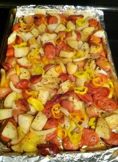 Oven Roasted Sausage   1. spray a large baking pan w/ nonstick spray . 2、slice sausages into thin rounds, about 1/5″ thick. 3、cut potatoes into 1/2″ chunks 4、slice onion and pepper into strips 5、place all ingredients on baking sheet and drizzle oil over 6.  Sprinkle with salt and pepper 7. Bake at 400 for 30-35 mins