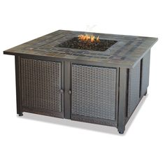 Guildhall Gas Fire Bowl combines a hand-crafted slate tile mantel and copper accents with durable, weather-resistant steel. A simulated wicker base, cleverly conceals the propane tank beneath.