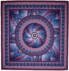"Kaliedoscopic quilt by Jinny Beyer.  Jinny says: ""I love quilts that have movement or create optical illusions"""