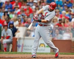 St. Louis Cardinals' Matt Adams hits a two-RBI double against the Chicago Cubs during the first inning of a baseball game on Saturday, July ...