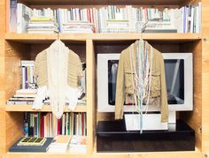 Inside The Closet of Fashion Designer Michelle Elie: Between her Comme des Garçons and Prada archive, incredible decor and art collection, Michelle Elie is one for the books (so we put her in ours). - Tan sweater and pearls.   Coveteur.com