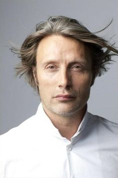 Mads Mikkelsen. I'm blowing on my phone screen