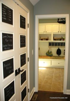 chalkboard on raised door panels - paint laundry cabinet door fronts?  Fill door grooves and do this.