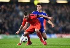 Marco Verratti of PSG is challenged by Cesar Azpilicueta of Chelsea during the UEFA Champions League round of 16 second leg match between Chelsea and Paris Saint-Germain at Stamford Bridge on March 11, 2015 in London, England.