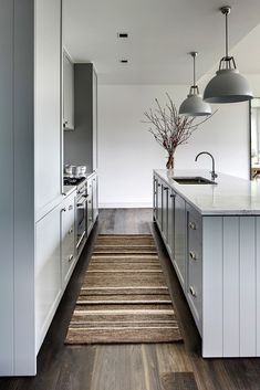 Simple kitchen with gray cabinets and stripe runner.