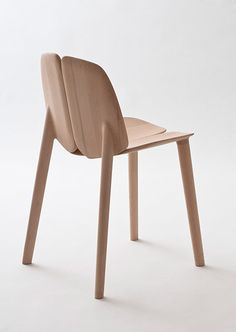 Osso chair by Ronan and Erwan Bouroullec, produced by Mattiazzi  This chair, made of four distinct pieces, combines computer-cutting machinery and traditional craftsmanship