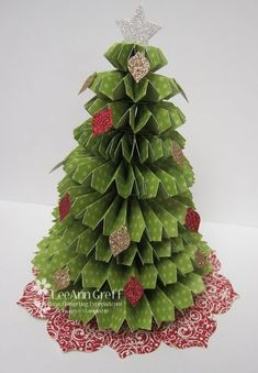 Rosette Christmas Tree Tutorial from Flowerbug's Inkspot.  GREAT easy to follow photo instructions using lots of strips and scoring.  Would be cute table top decorations.