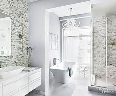 Create a contemporary bath with sophisticated style by emphasizing form rather than color.