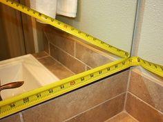 Fabulous tutorial for Framing A Bathroom Mirror