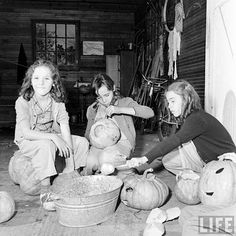 vintage Halloween photo of girls carving pumpkins children retro antique pumpkin 1941 Life magazine