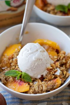 This peach crisp with almond coconut ice cream is the perfect summer dessert! It's loaded with sweet peaches, sprinkled with a crisp oat crumble and topped with a scoop of creamy coconut almond ice cream.