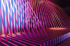 NIKE FLYKNIT Berlin 2014 A temporary immersive installation was designed to transform completely the space of the Puro Sky Lounge on the 22nd floor of the iconic Europacenter in Berlin. The design was developed in collaboration with onedotzero and commissioned by NIKJE. It consisted of 2km of tape, organised in 2 vivid colours, and arranged to create dynamic tension and optical effects that animated the whole environment