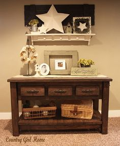 ...she took a sofa table and added extra boards along the bottom, stained it, and uses it to hold lovely baskets! :D