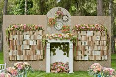 amazing ceremony backdrop made from open books and a mantel