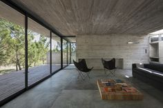 House is a concrete holiday retreat designed by Luciano Kruk in Costa Esmeralda, Buenos Aires, Argentina. Concrete House in Argentina Concrete Architecture, Contemporary Architecture, Concrete Interiors, Concrete Houses, Concrete Design, Concrete Color, Cool Apartments, Modern Interior Design, Home Furniture