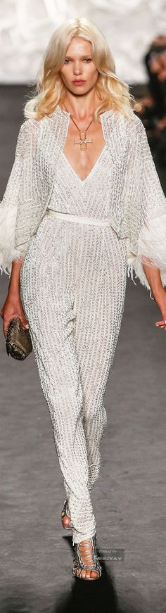 I would wear this 2015 Naeem Khan.jumpsuit with a cropped black leather jacket and strappy silver heels to a slightly more casual event.