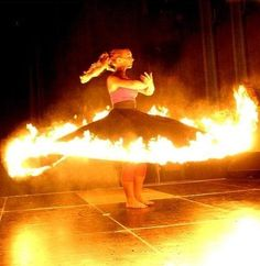 fire dervish. oh crap what's she gonna do about that fire when she's not spinning anymore?