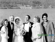 "The wedding of Adelia ""Ada"" Clooney and Norman Zeidler, center, included this moment with Clooney family members March 14, 1987 on the banks of the Ohio River in Augusta, Ky. From left, Nina and her husband, Cincinnati WKRC-TV anchorman Nick Clooney, their daughter and new son-in-law, Nick's sister, Hollywood star Rosemary and bride's 26-year-old brother, actor Grorge. The wedding was a hometown affair. A roll of fence wire, tied with gift ribbons, marked off the curb in front of the ..."