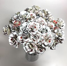 Poker Centerpiece- Custom order of four dozen playing card flowers created by ThePaintedPetaler.com #casinoparty #vegaswedding #playingcards