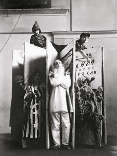 Varvara Stepanova's designs for the performance of 'An Evening of the Book' with the protagonists standing in front, photographed by Alexander Rodchenko (1924)  © Rodchenko Stepanova Archives, Moscow