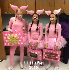 3 Little Pigs group costume. Long johns dyed to match felt ears glued to headband. 3 different colors of pink used in tutu. Candy bag has straw, stick, & bricks glued onto front.