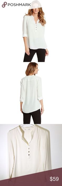 """marciano • corianne ivory silk split neck top • s The flowing fit and high-shine details lend ethereal glamour to the otherwise minimal design. Silk popover blouse. Long sleeves w/ double-barrel cuffs. 4-button front placket. Pleated detail at shoulders. Gold tone hardware.   • sz S • 39"""" bust, 14"""" shoulder to shoulder, 23"""" sleeve length, 26.5"""" length • color: off white • 100% silk • never worn  • FLAWS: couple of very minor pulls due to delicate nature of fabric, nothing noticeable…"""