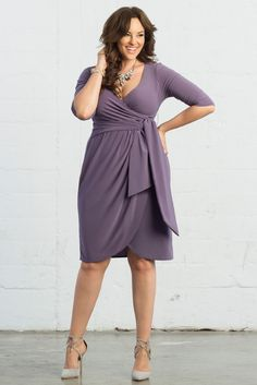 Need a cocktail dress? Plus size evening wear? Try our Harlow Faux Wrap Dress in Lavender Fields! With elegant draping, faux wrap dress styling and 3/4 sleeves, you'll feel confident in this made in the USA dress. Shop www.kiyonna.com #kiyonna #plussize #dresses