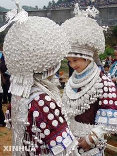 Girls of the Miao ethnic group wearing silver ornaments are seen during celebrations of the Lusheng Festival. China