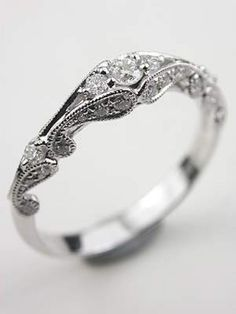 antique styled engagment ring in love. I would use it as my wedding band