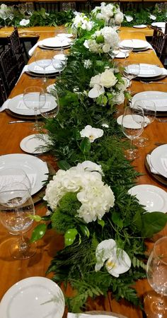 Royal Table Setting by A Marc In Design Ft Lauderdale Fresh garland, accented with floral components , enhanced with white phalaenopsis orchids. Fresh stephanotis vibe and assorted greenery.