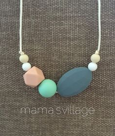 Silicone Teething Necklace / Silicone Nursing by MamasVillage (I like the colors in the picture I pinned.)