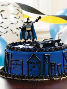 Batman Cake, love the piping but minus the figure and buildings and add the bat symbol in yellow